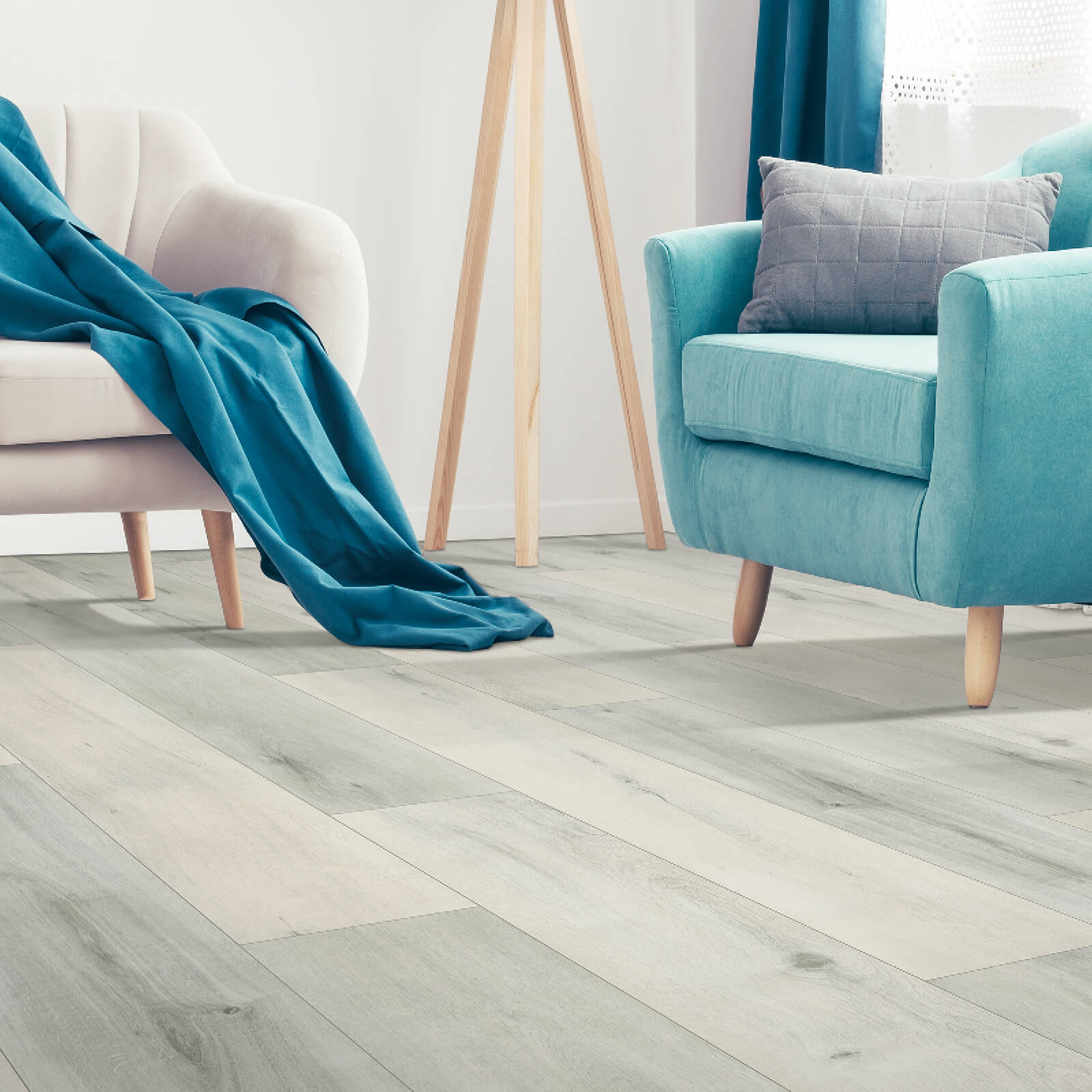 Blue couch on Laminate flooring | Staff Carpet