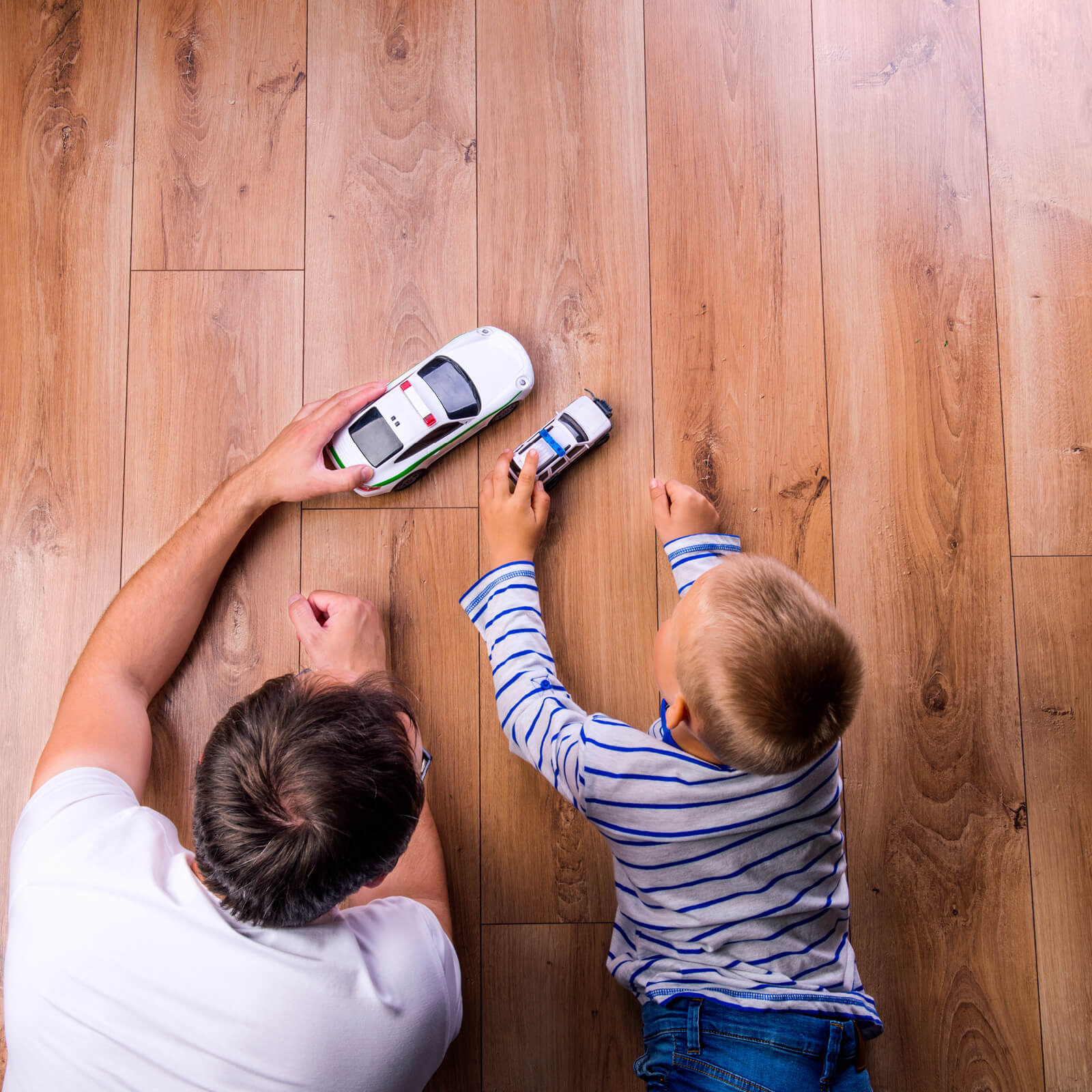 Father and kid playing with toycar | Staff Carpet
