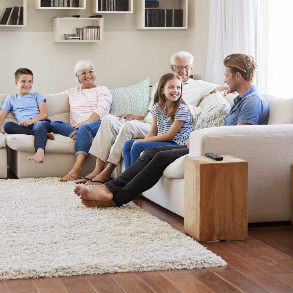 Family enjoying in living room | Staff Carpet